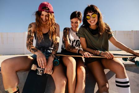 Best friends spending time at skate park
