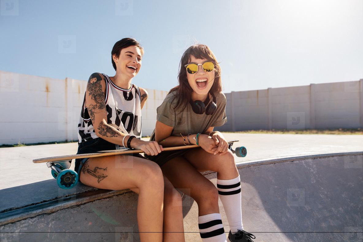 Female friends enjoying a day at skate park