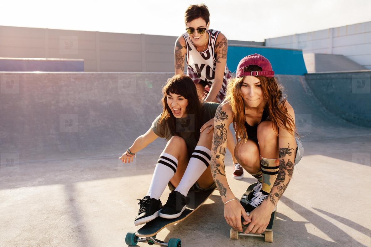Girls having fun with skateboard in the skate park