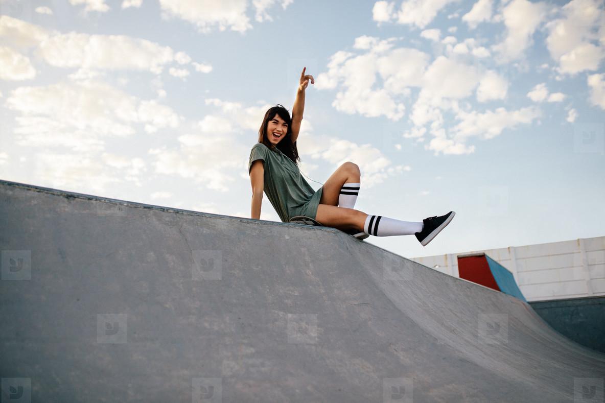 Female skateboarder enjoying a day at skate park