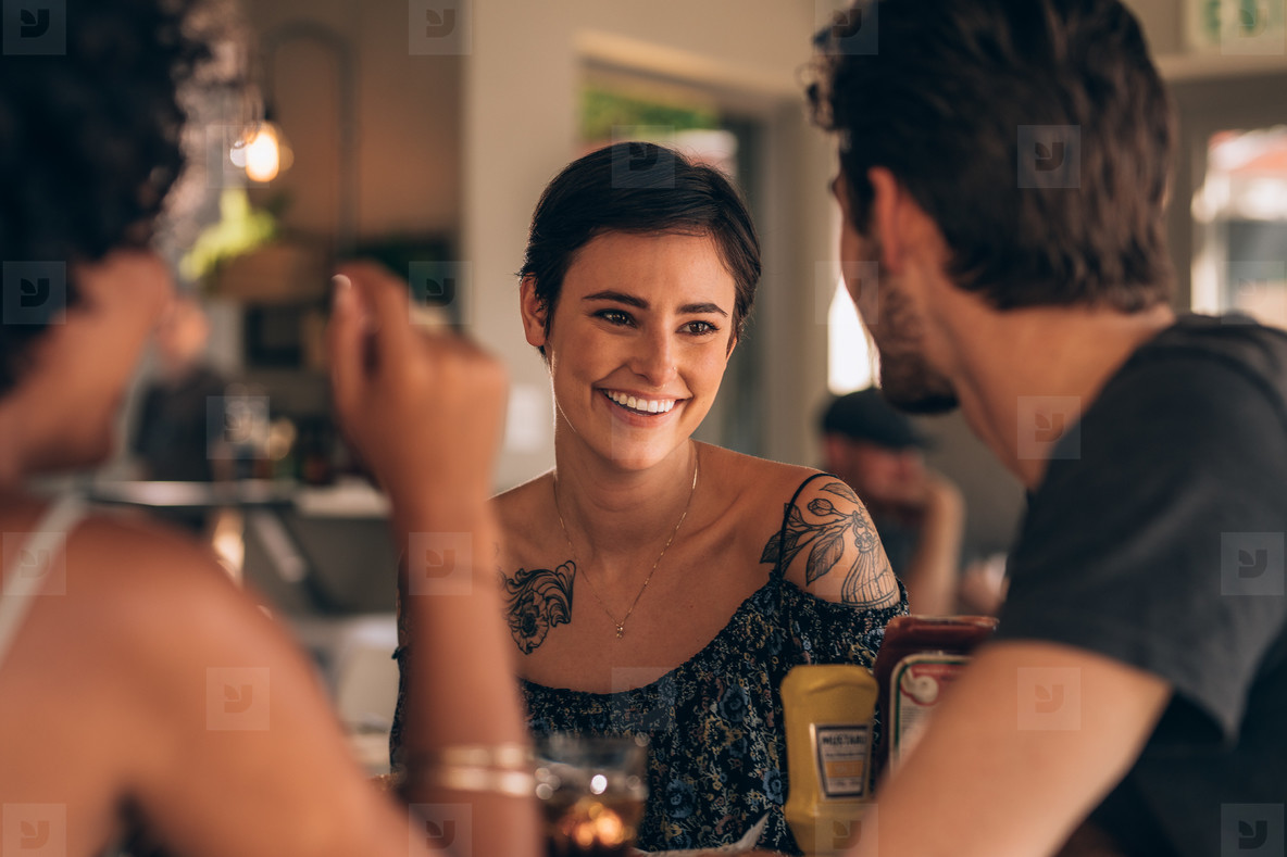 Woman with best friends at restaurant