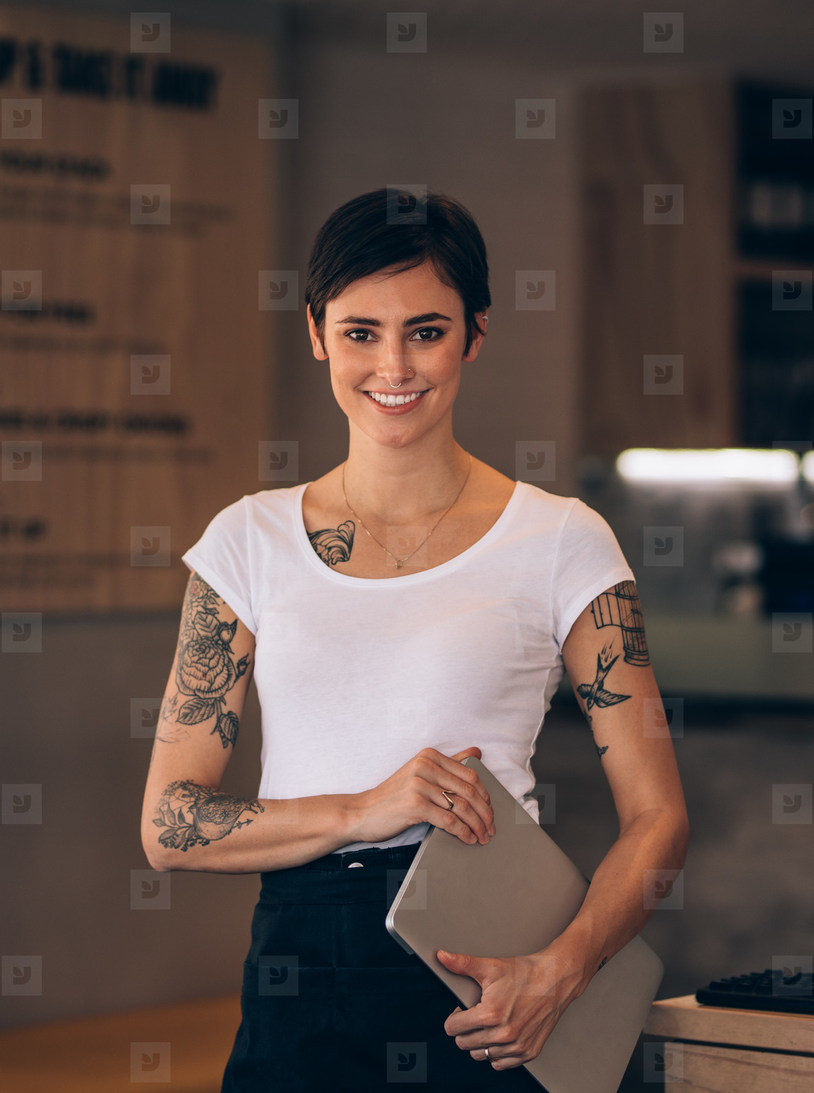 Beautiful female restaurateur with laptop