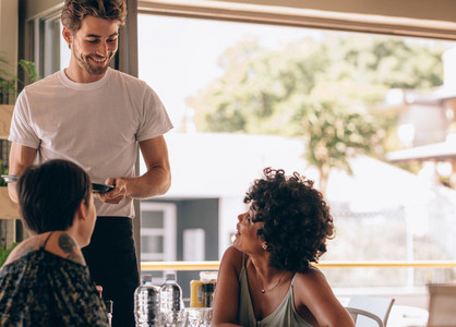 Female friends at restaurant