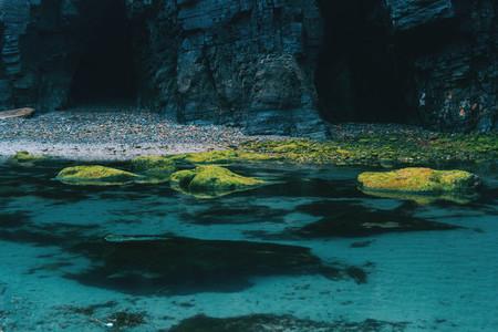 Beach with moss stones lugo