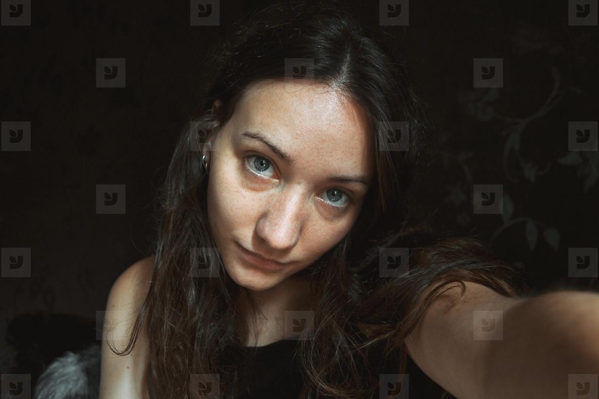 pretty girl doing a self portrait indoors