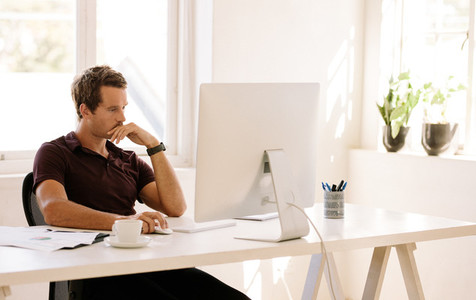 Entrepreneur working on computer at home