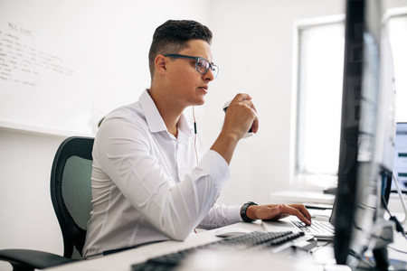Application developer working on computer in office