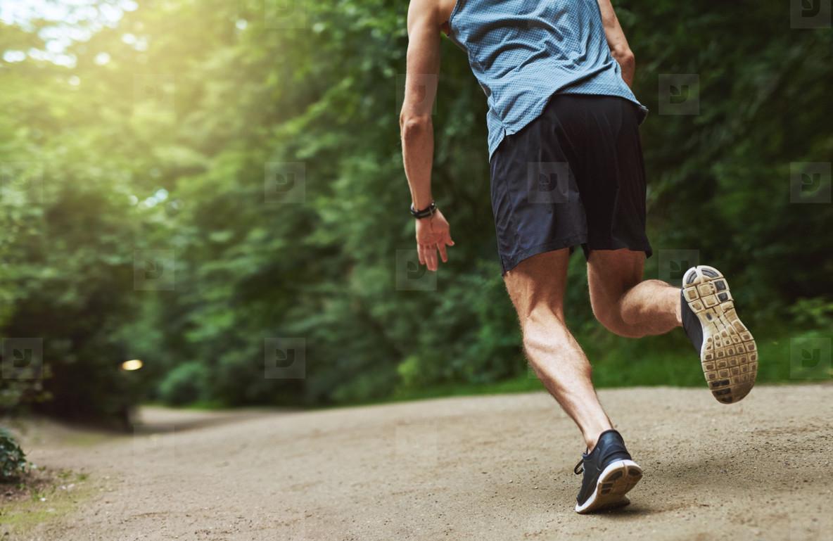 Headless Rear View Shot of Man Running at the Park