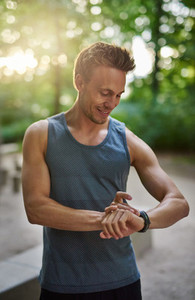 Muscular Man Checking his Watch After his Exercise