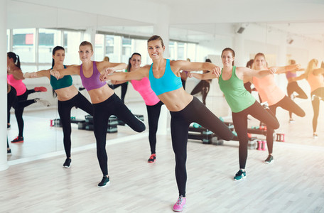 Group of fit young women working out in a gym