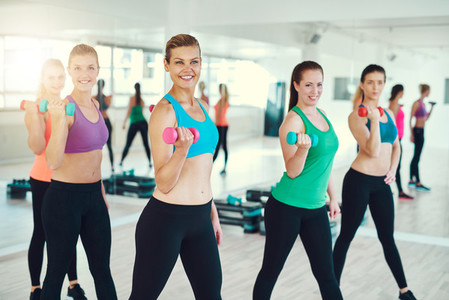 Group of young women doing dumbbells