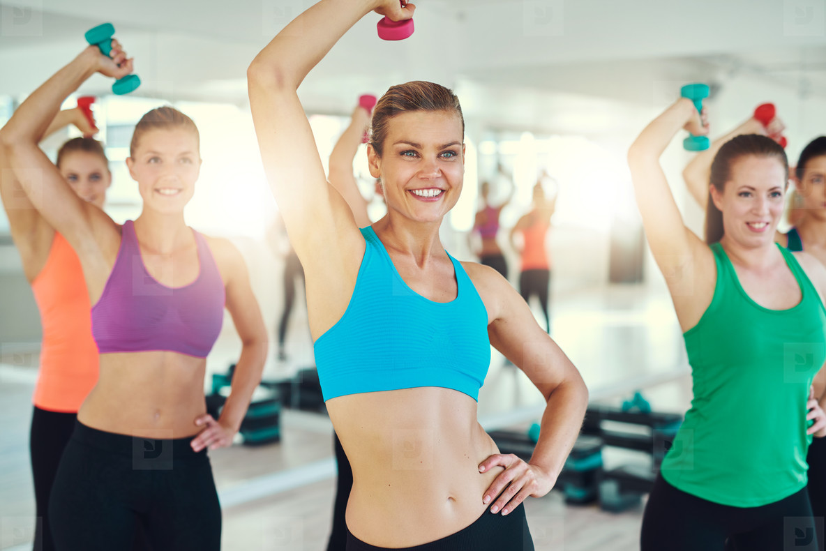 Close up of young women doing exercise on triceps