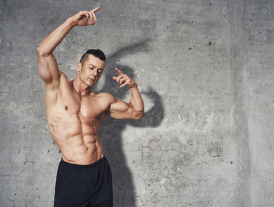 Fitness model posing showing abdominal muscles