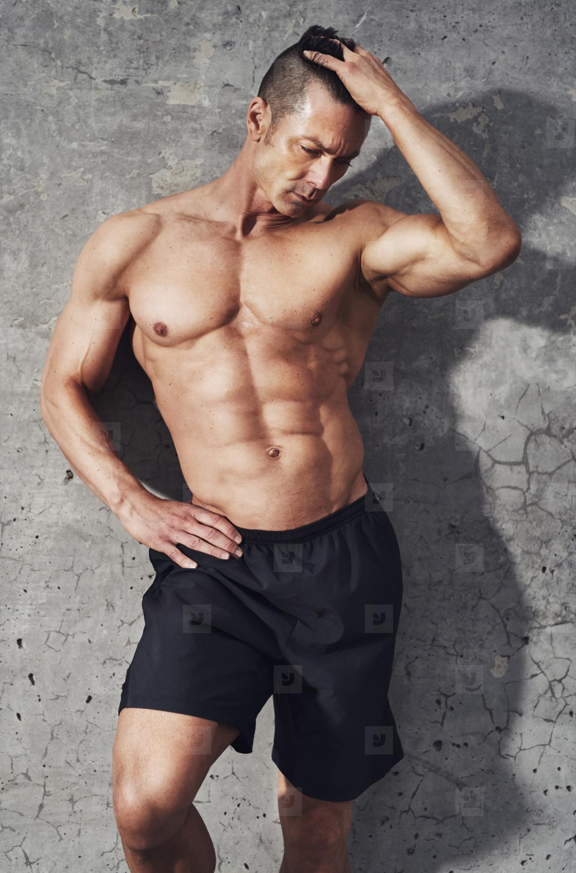Fitness model portrait muscular build man relaxing