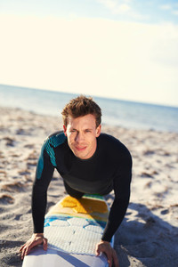Male Surfer Showing How to Pop Up on Surfboard