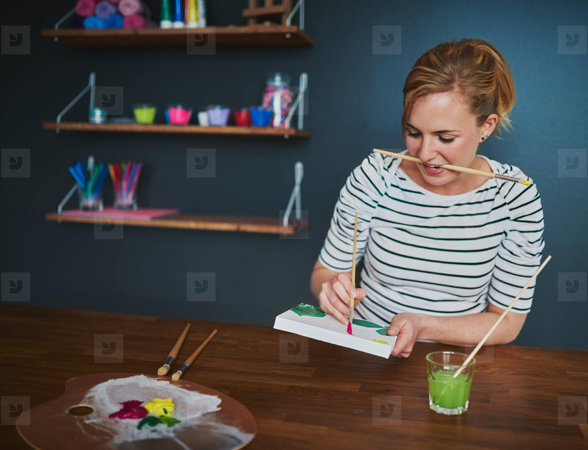 Woman making a painting