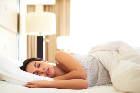 Young woman asleep on her side
