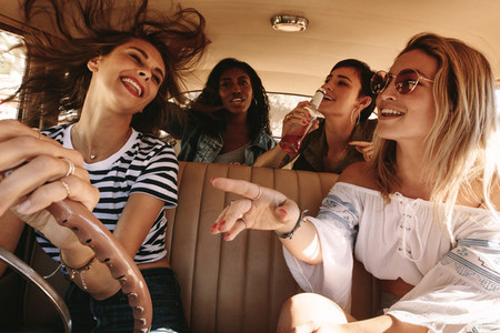 Girls having fun on road trip