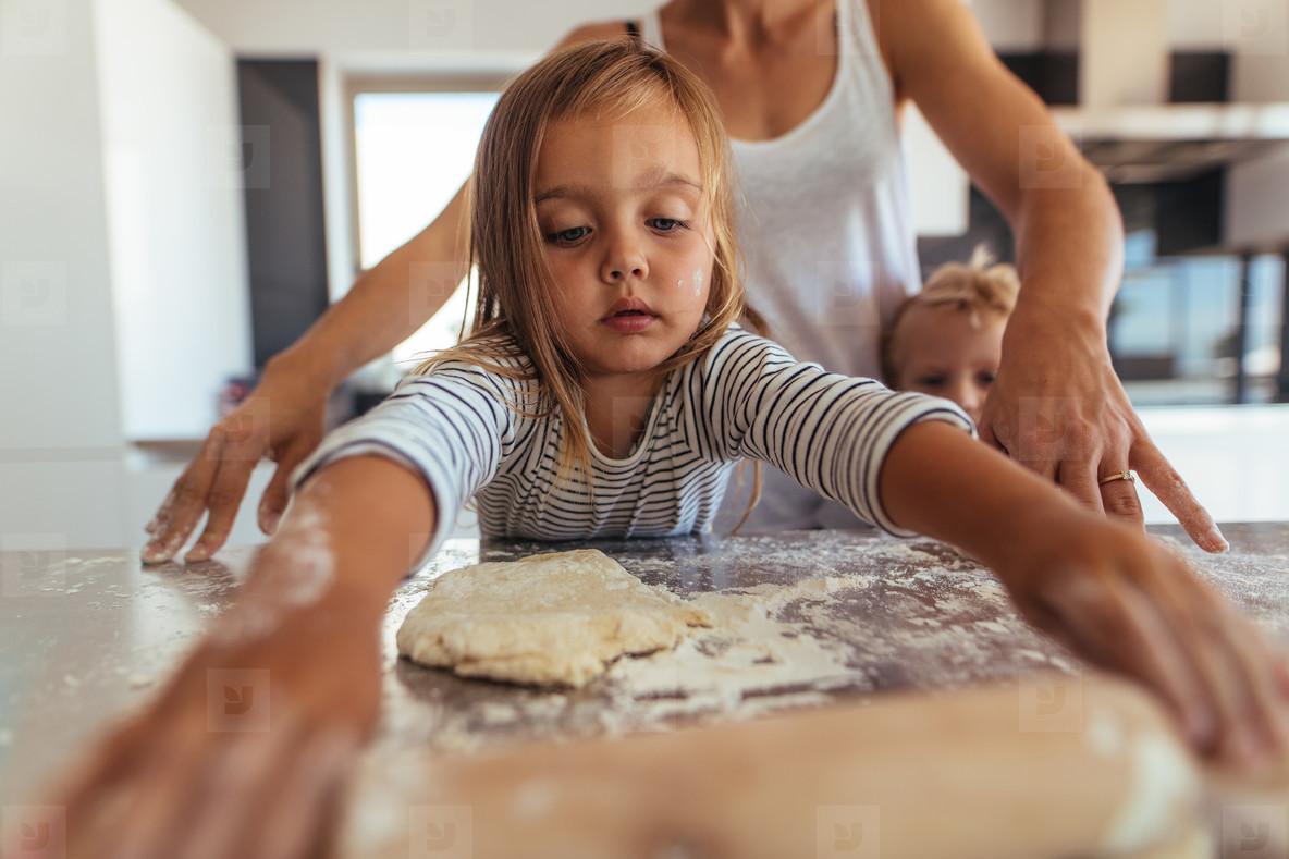 Little girl learning cooking and baking