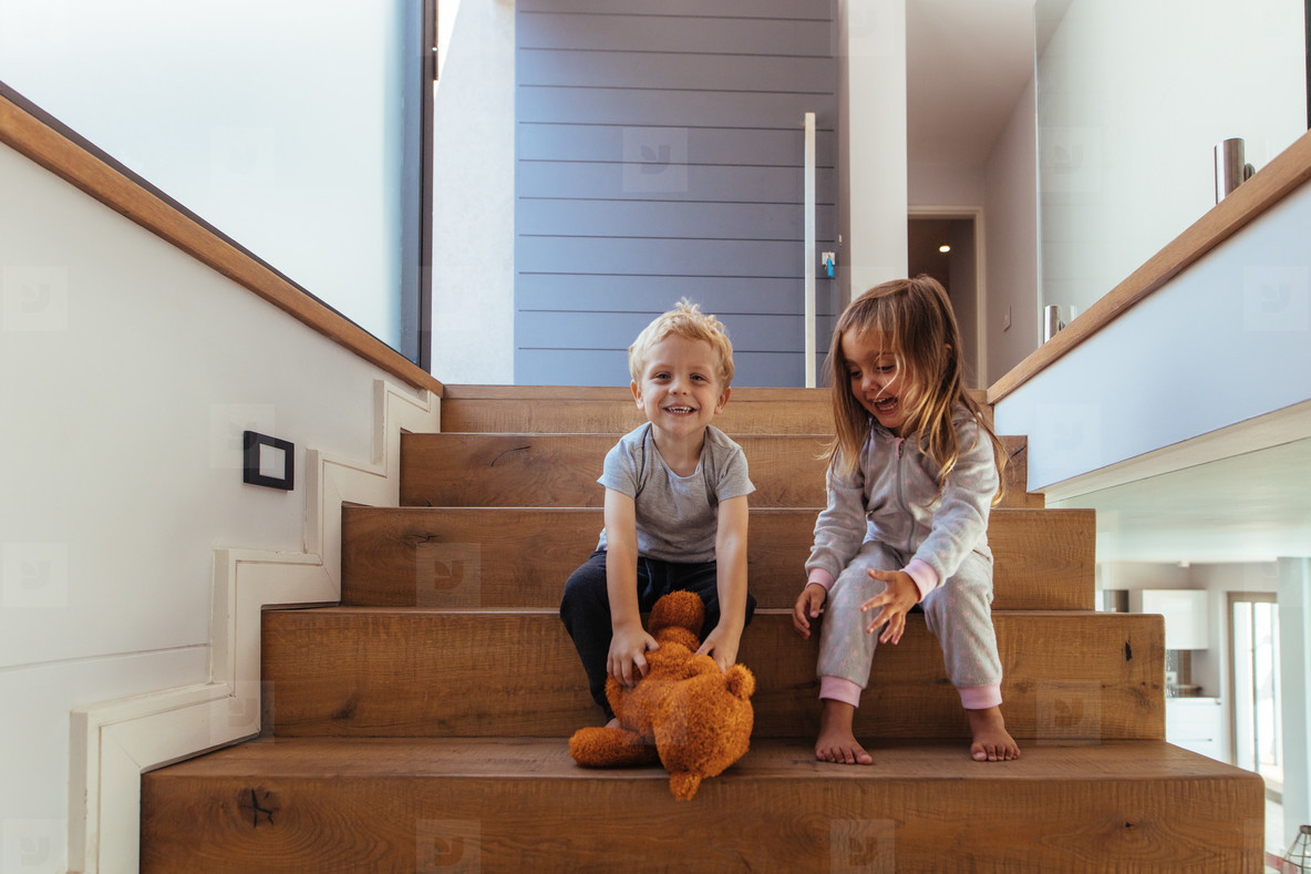 Children playing with teddy bear