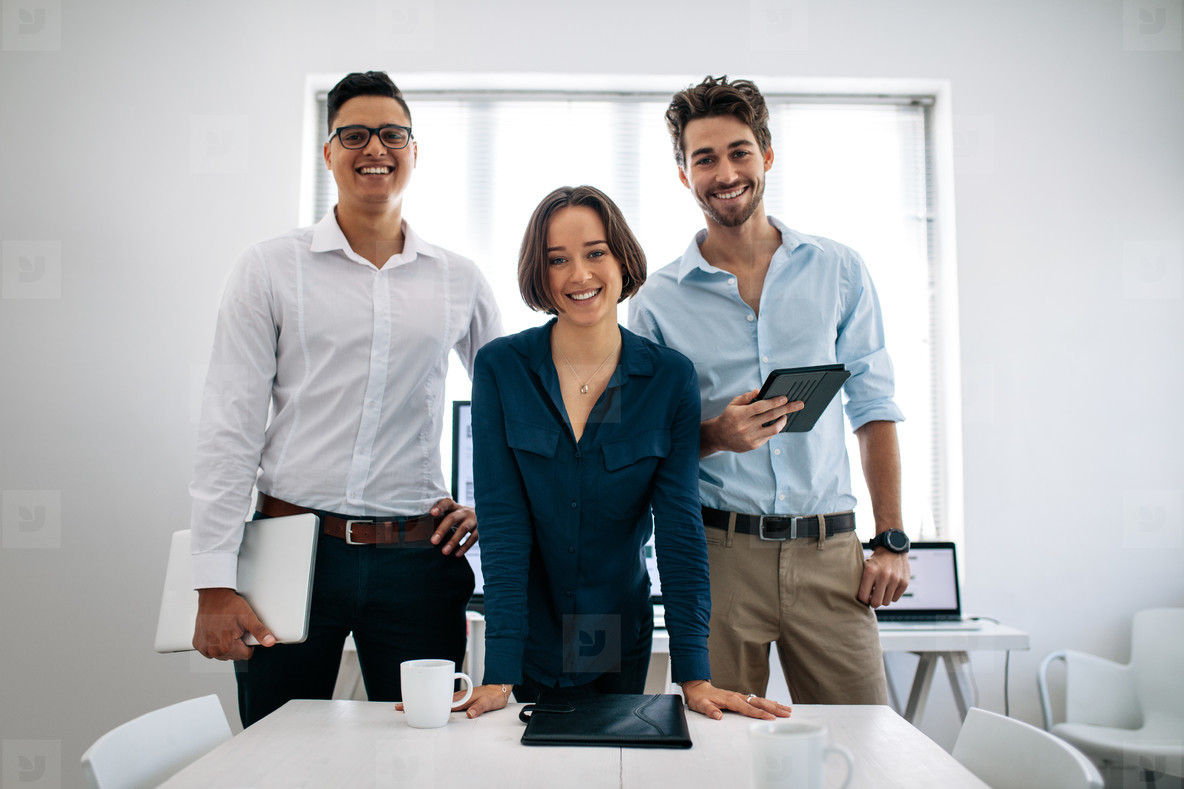 Business colleagues standing in meeting room