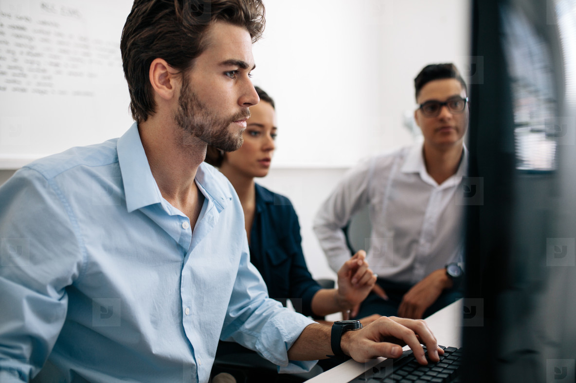 Application developers working on computers in office