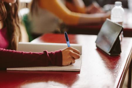 Girl studying in university classroom