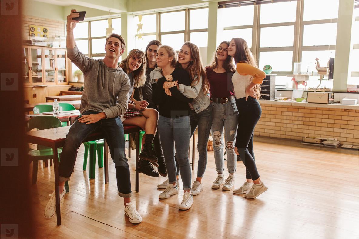 Students in classroom taking selfie