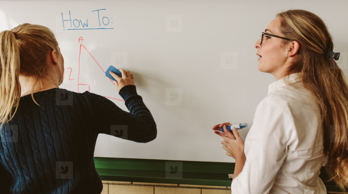 Student with teacher in geometry class