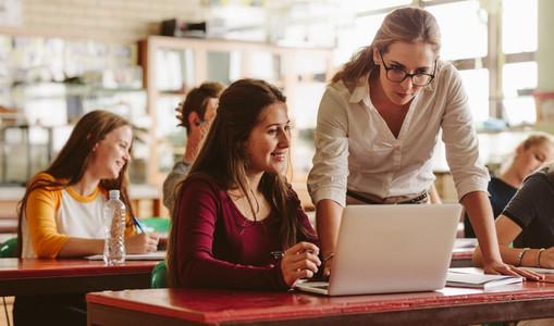 Teacher helping a student during class