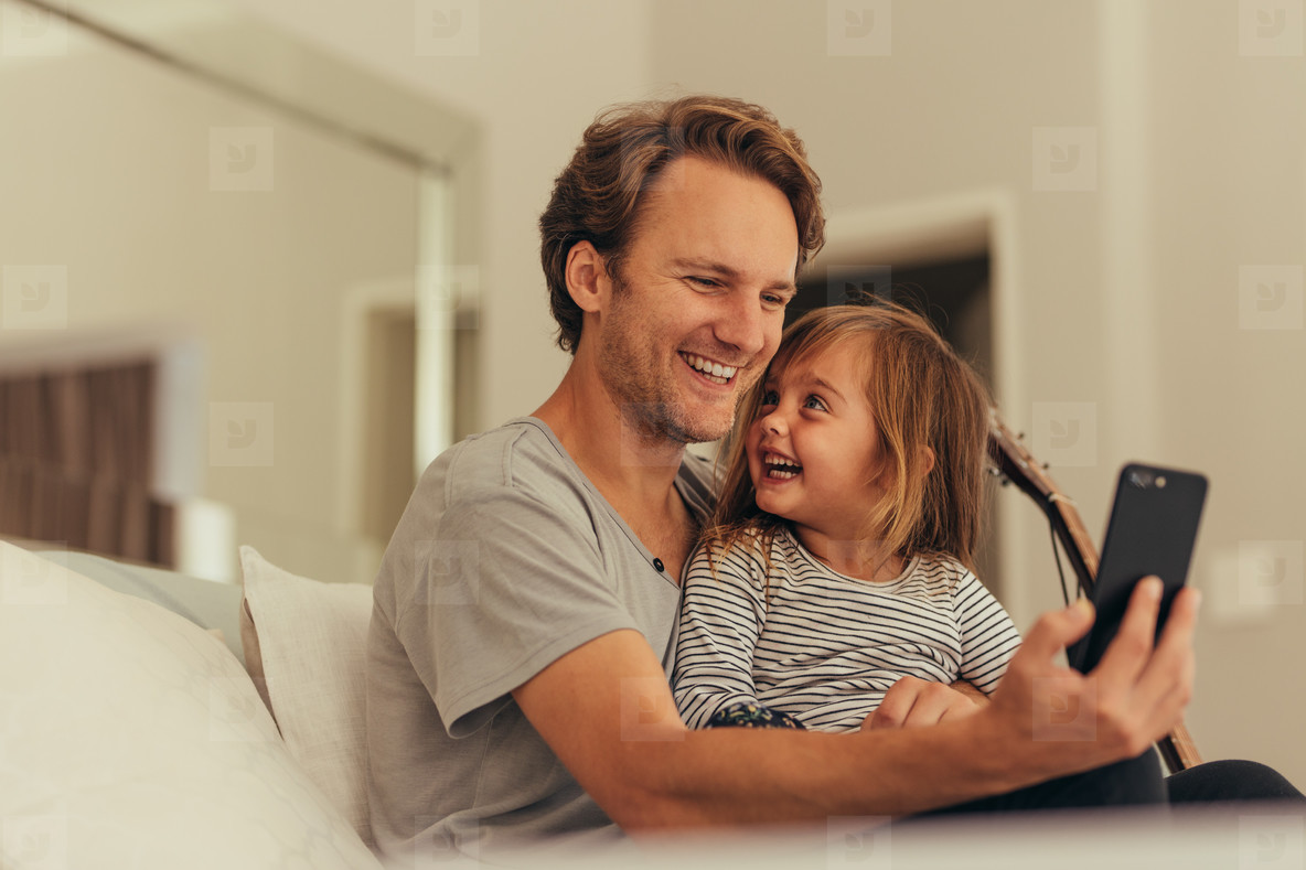 Father and daughter spending time together at home