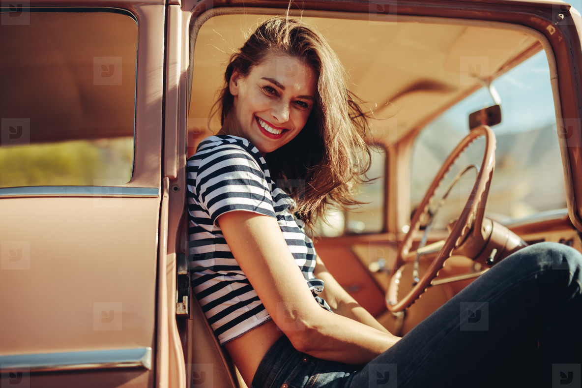 Smiling woman on front seat of a car