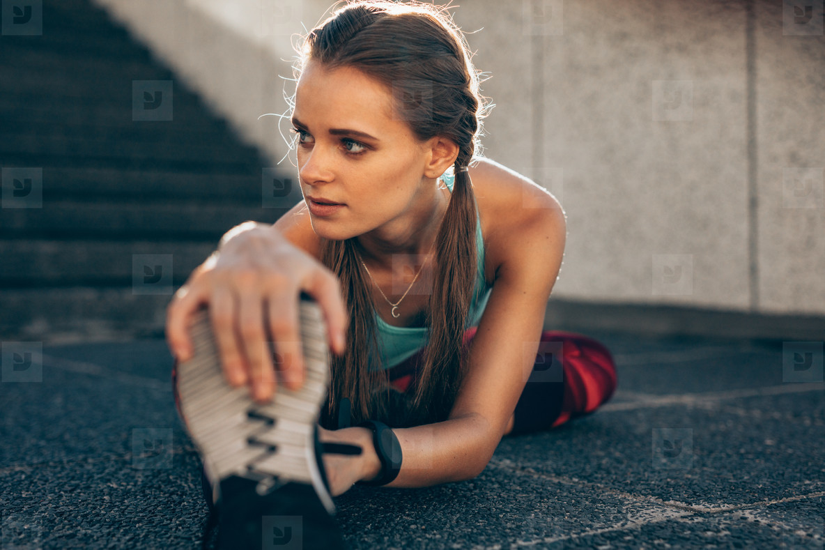 Woman doing stretching workout in morning