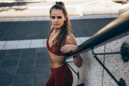 Fitness woman relaxing after workout