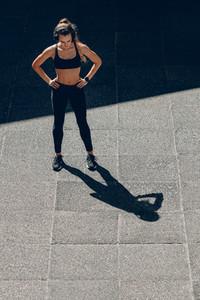 Sportswoman taking break after running workout