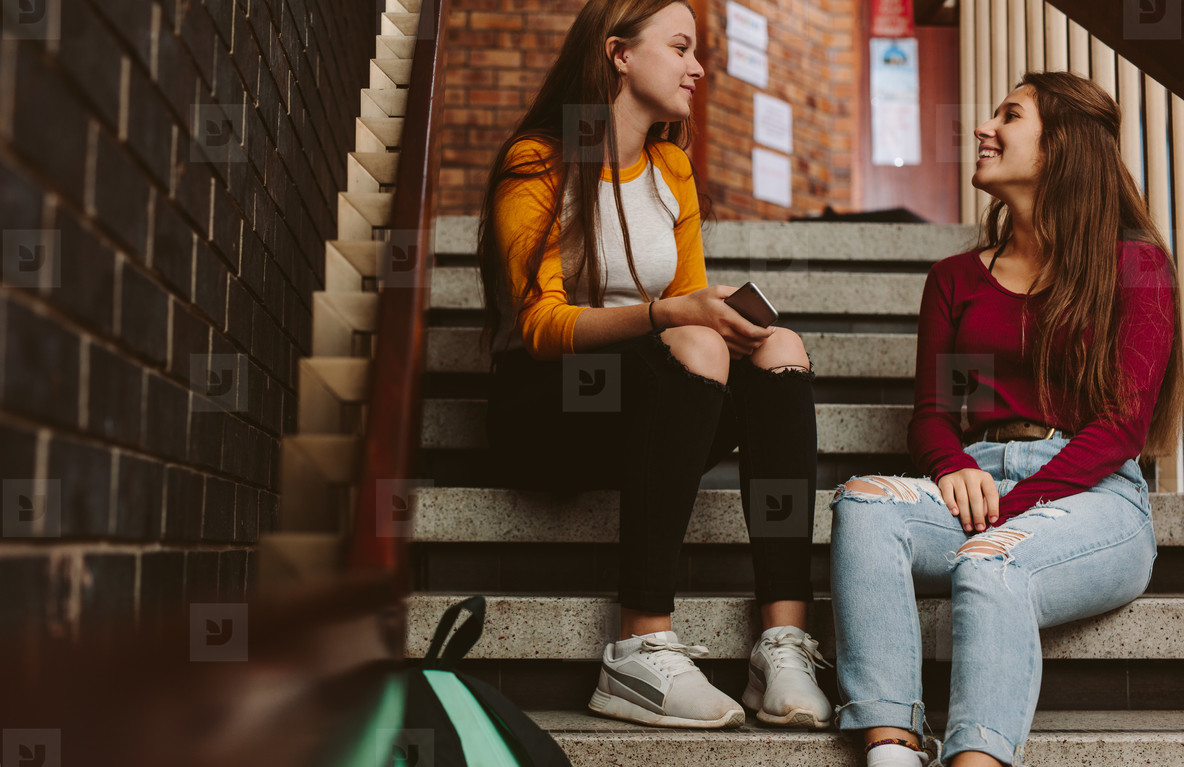 University students chatting during break on campus