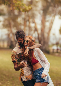 Hippie couple having fun at music festival