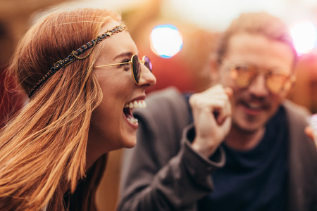 Hippie girl enjoying with friends at music festival
