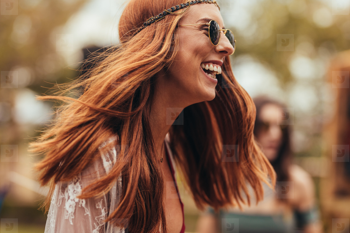 Laughing woman in retro look at music festival