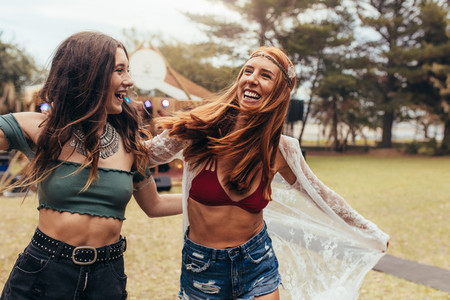 Girls having a great time at music festival