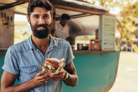 Man having food truck burger