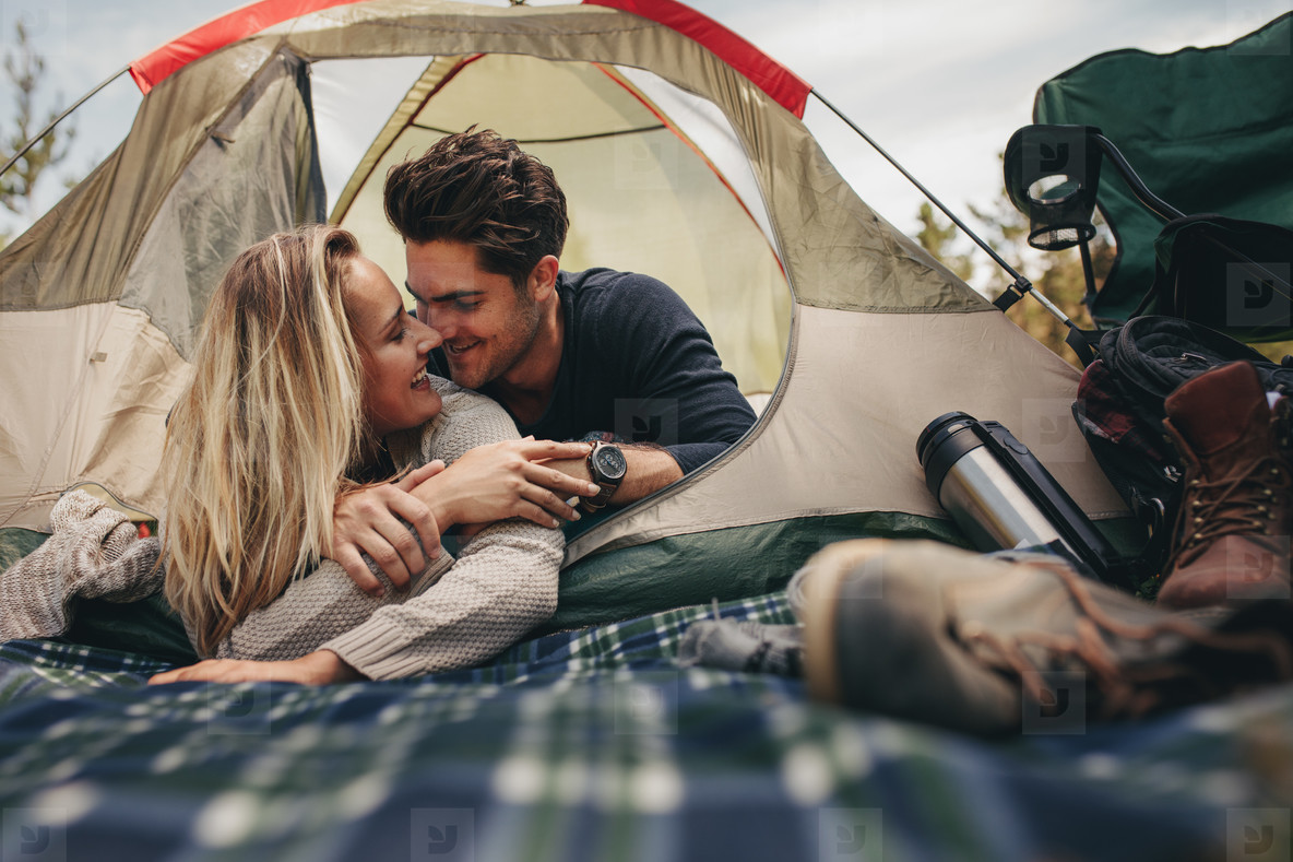 Romantic couple camping in nature