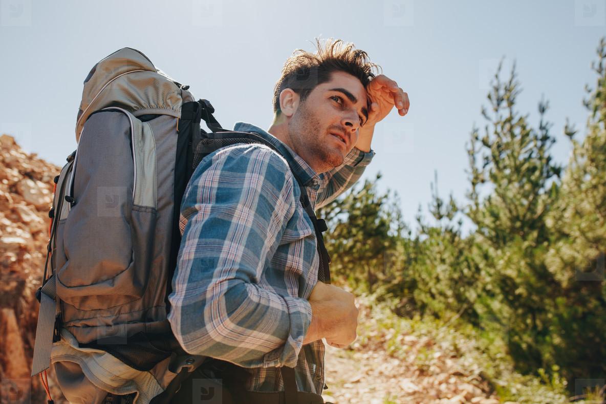 Man exploring nature walking through mountain trails