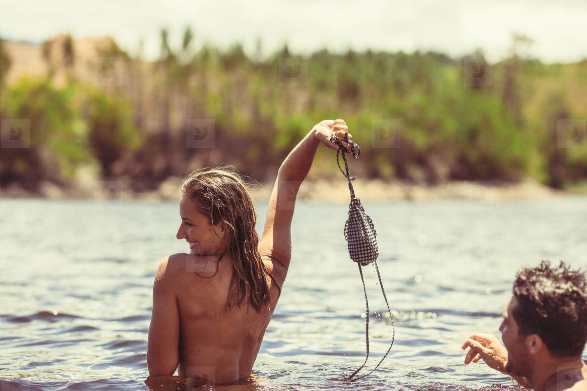 Couple having fun in a lake
