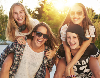 Teenage girls laughing