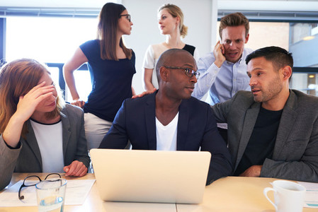 Group of executives sitting working intensely