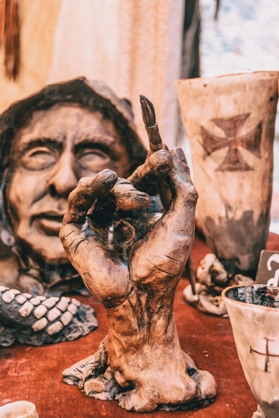 sculpture of a hand holding a pen