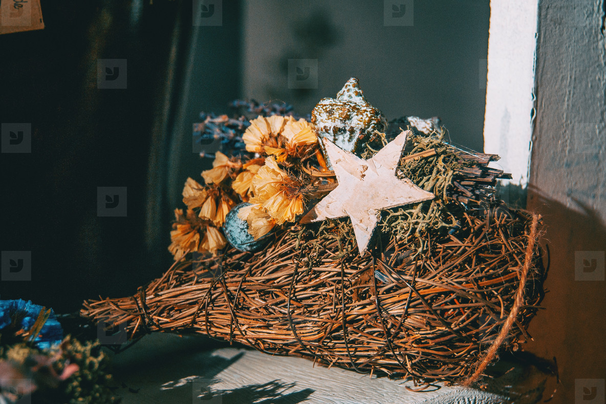 Bouquet of flowers and dry leaves with a wooden star