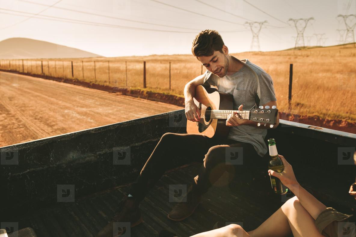 Couple enjoying on a road trip in their car
