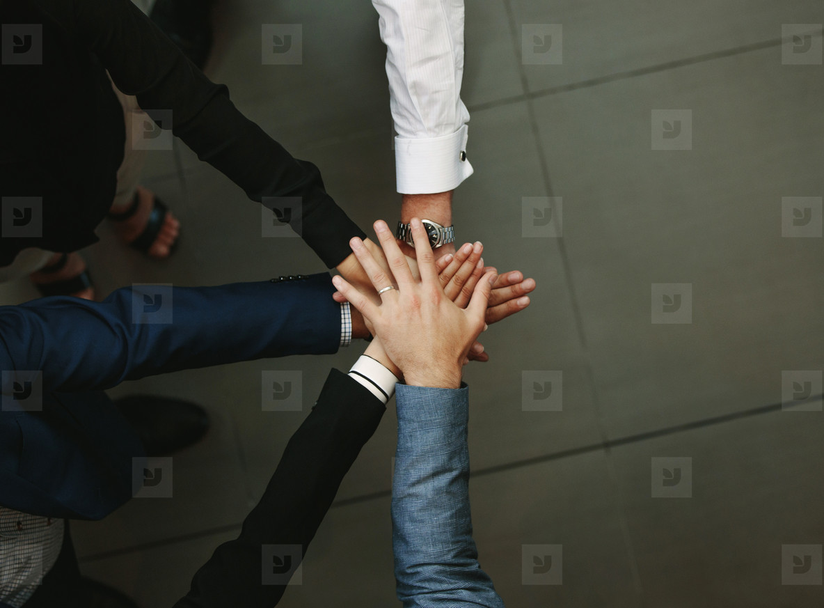 Business group putting hands together